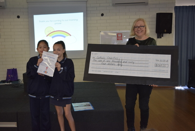 St Augustine's Parish School Fun Day Cheque handover.jpg